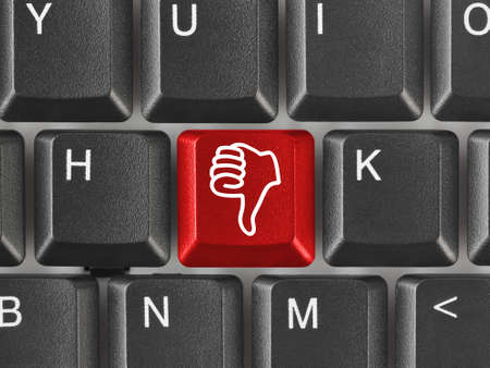 Computer keyboard with thumb gesturing hand key photo