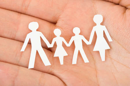 Paper family in hand - home concept Stock Photo - 7474445