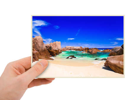 Beach photography in hand (my photo) isolated on white background Stock Photo - 7646175