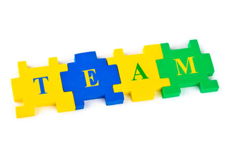 Puzzle Team isolated on white background Stock Photo - 7664220