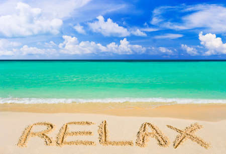 rest and relaxation: Word Relax on beach - vacation concept background