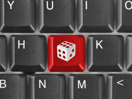 game of chance: Computer keyboard with dice key - technology background