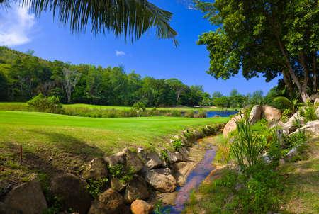 Golf field at island Praslin, Seychelles - nature background photo
