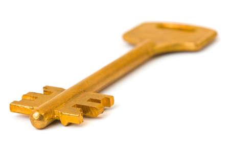 Macro of retro gold key isolated on white background Stock Photo - 7685476