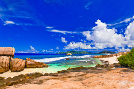 argent: Tropical beach at Seychelles - vacation nature background