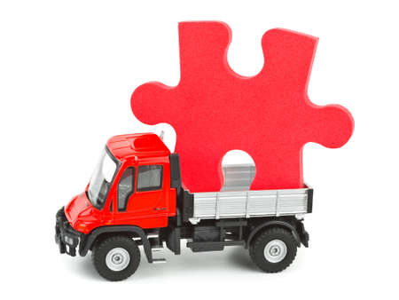 Toy car truck with puzzle isolated on white background photo