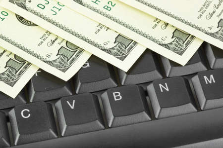 Computer keyboard and money - concept business background photo