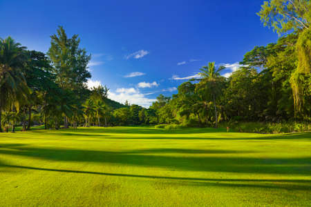 resorts: Golf field at island Praslin, Seychelles - sport background