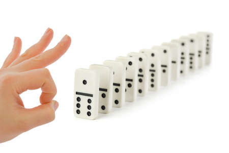 Hand and domino isolated on white background photo