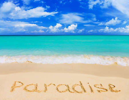 tropical paradise: Word Paradise on beach - concept travel background Stock Photo