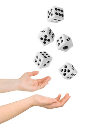 Hands throwing big dices isolated on white background photo