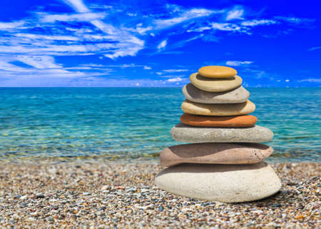 cairn: Stack of stones on beach - nature background