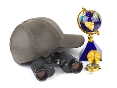 Binoculars, cap, compass and globe - travel concept photo
