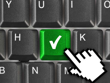 Computer keyboard with agreement key - technology background photo