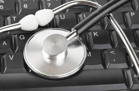 bug key: Stethoscope and computer keyboard - technology background