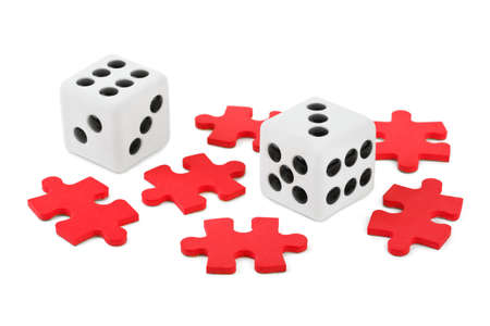 Dices and puzzle isolated on white background photo