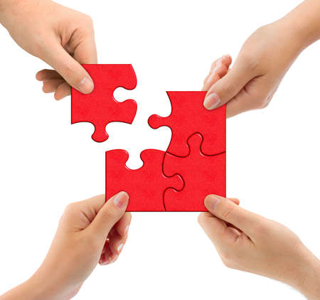 team building: Hands and puzzle isolated on white background
