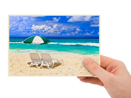 Beach photography in hand (my photo) isolated on white background Stock Photo - 7988013