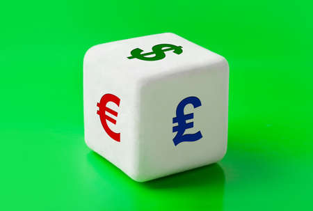 Dice with money symbols - business concept background photo
