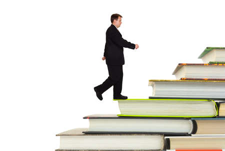Man and book stairs isolated on white background photo