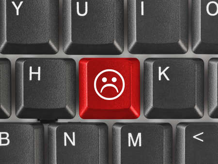 dissatisfaction: Computer keyboard with smile key - business concept