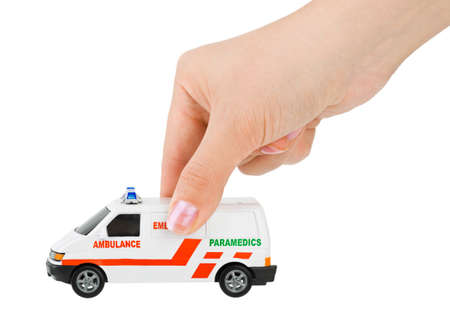 Hand with toy ambulance car isolated on white background Stock Photo - 8164113