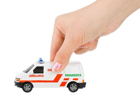 Hand with toy ambulance car isolated on white background Stock Photo - 8164113