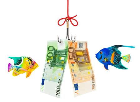 Fishing hook and money isolated on white background photo