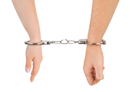 wristbands: Man and woman hands and breaking handcuffs isolated on white background Stock Photo