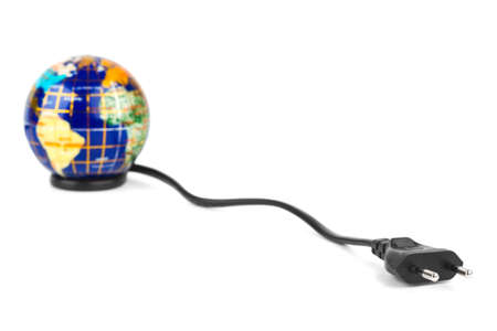 Globe and electrical cable isolated on white background photo