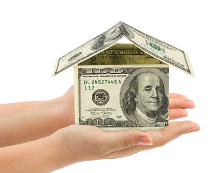 Hands and money house isolated on white background Stock Photo - 8249769