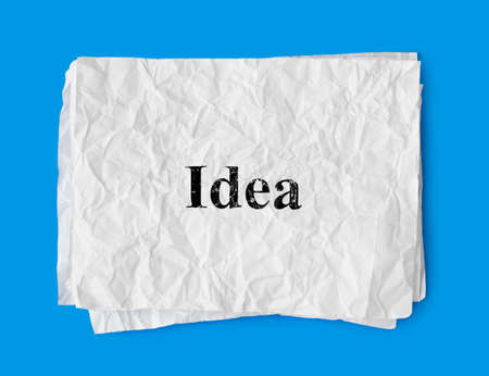 Crumpled paper Solution isolated on blue background photo