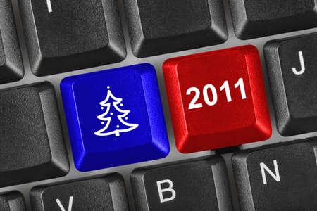 Computer keyboard with Christmas keys - holiday concept photo