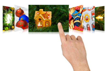 scrolling: Hand scrolling christmas images (my photos) - isolated on white background
