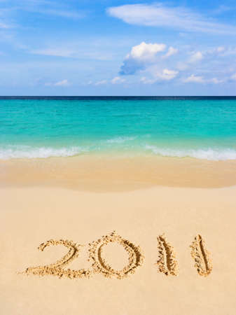Numbers 2011 on beach - concept holiday background Stock Photo - 8325429