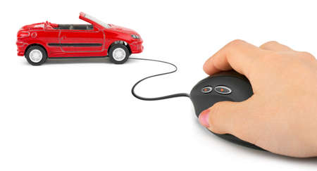 Hand with computer mouse and car isolated on white background photo