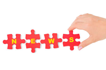 Hand and puzzle News isolated on white background photo