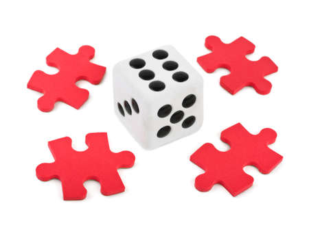 Dice and puzzle isolated on white background photo