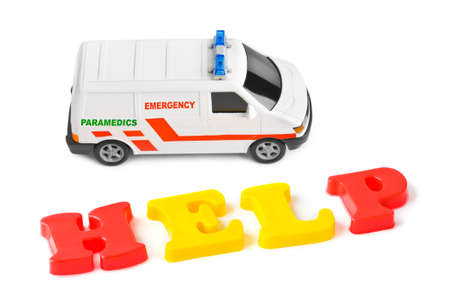 Toy ambulance car and word help isolated on white background Stock Photo - 8403748
