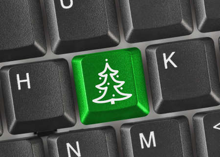 Computer keyboard with Christmas tree key - holiday concept Stock Photo - 8403744