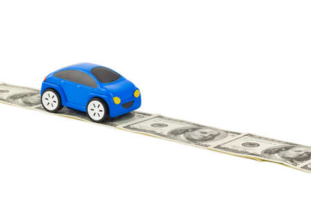 Toy car on money road isolated on white background photo