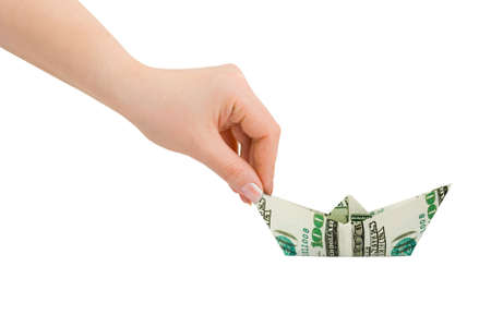 Hand and money ship isolated on white background photo