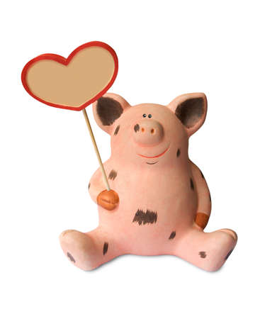 Toy pig with heart isolated on white background photo