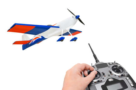 RC plane and radio remote control isolated on white background photo