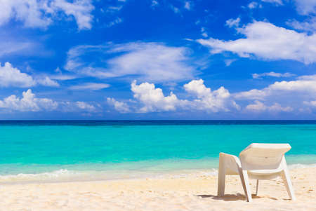 Chair on tropical beach, abstract vacations background photo