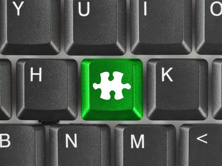 Computer keyboard with puzzle key - business background photo