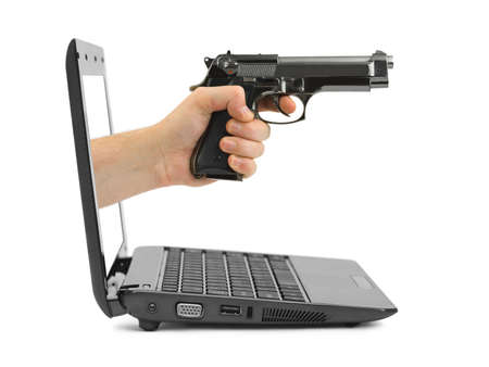 Hand with gun and notebook isolated on white background photo