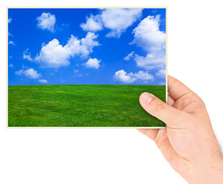 Nature photo in hand isolated on white background photo