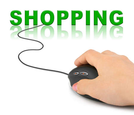 online trading: Hand with computer mouse and word Shopping - internet concept Stock Photo