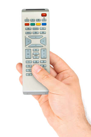 Hand with remote control isolated on white background photo